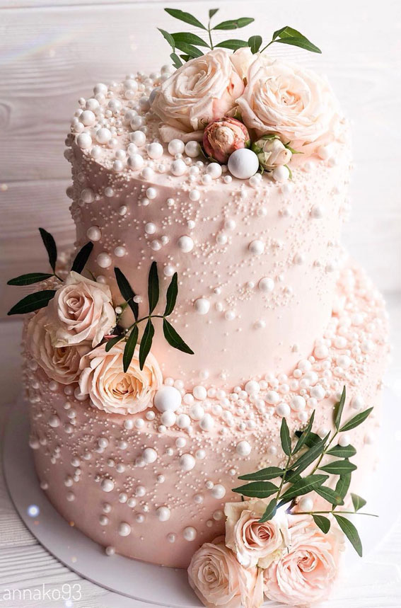 blush pink wedding cake, pearl wedding cake, two tier wedding cake, wedding cake, powder colored wedding cake , simple wedding cake #weddingcake #weddingcakes two tier white wedding cake adorned with flowers