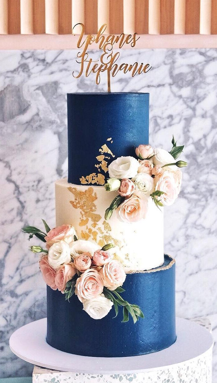 32 Jaw-Dropping Pretty Wedding Cake Ideas - Navy Blue And cream color adorned with roses three tier Wedding Cake, Three tier wedding cake,Wedding cakes #weddingcake #cake #cakes #nakedweddingcake