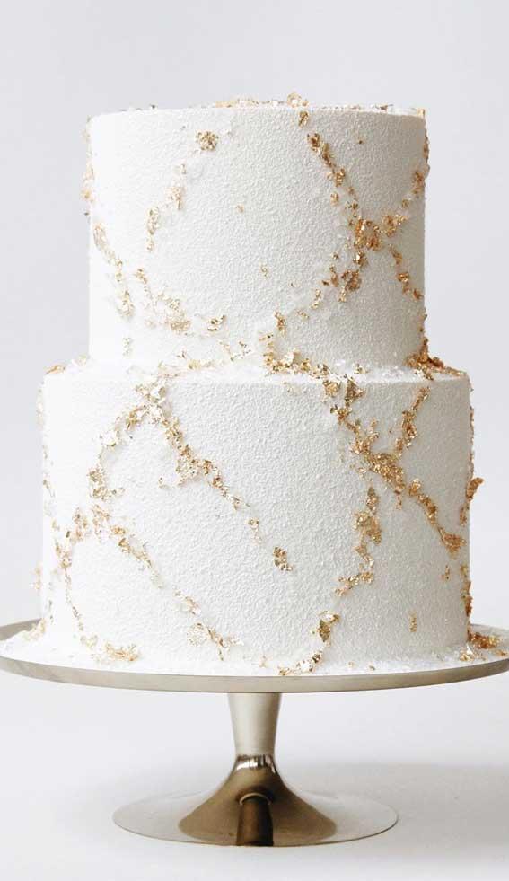 white wedding cake, white and gold wedding cake, wedding cake, wedding cake designs, wedding cake ideas, unique wedding cake designs #weddingcake #weddingcakes #cakedesigns wedding cakes 2020 , wedding cake designs 2020, wedding cake ideas #weddingcake #whiteandgold #weddingcakes