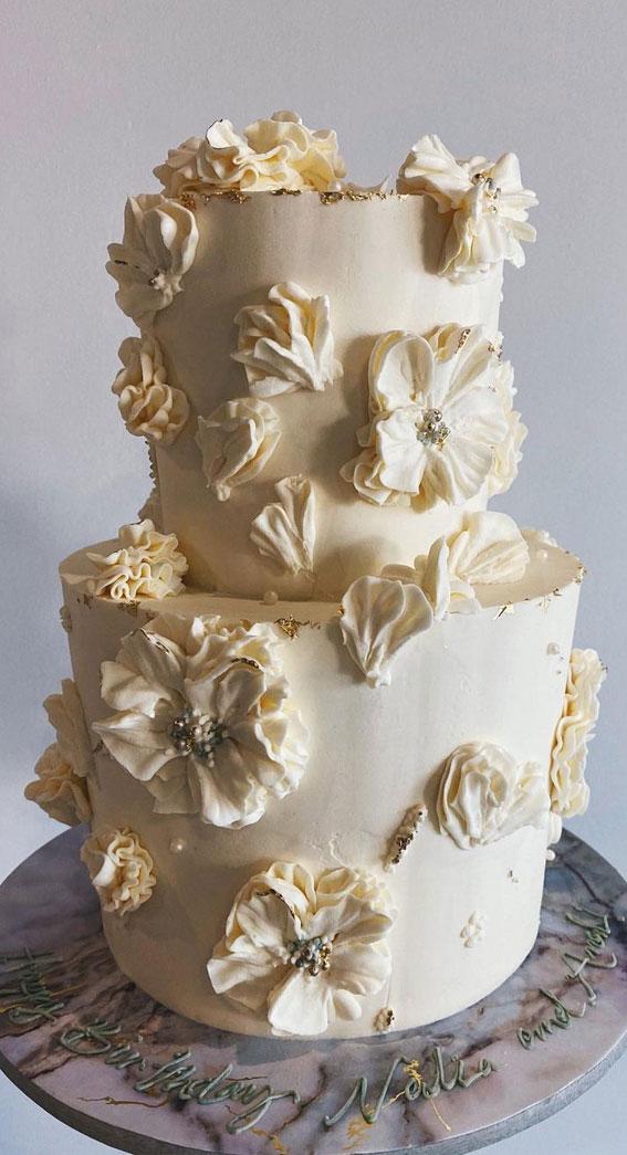 white buttercream wedding cake, flower ruffles, flower buttercream wedding cake #weddingcake #wedding #weddingcaketrends #weddingcakes2020 wedding cake ideas, wedding cakes 2020