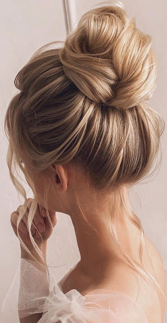 Trendiest Updos For Medium Length Hair To Inspire New Looks High Bun With Volume