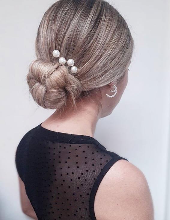 messy low bun, updo hairstyle, elegant updo hairstyles, hair updos for medium length hair, loose updos, updo braids, updo hairstyles for weddings, updo hairstyles for long hair, updo hairstyles messy