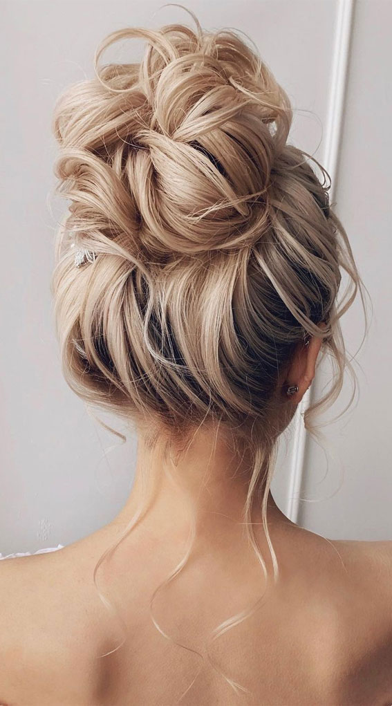 Updo Hairstyles For Your Stylish Looks In 2021 : Messy high bun