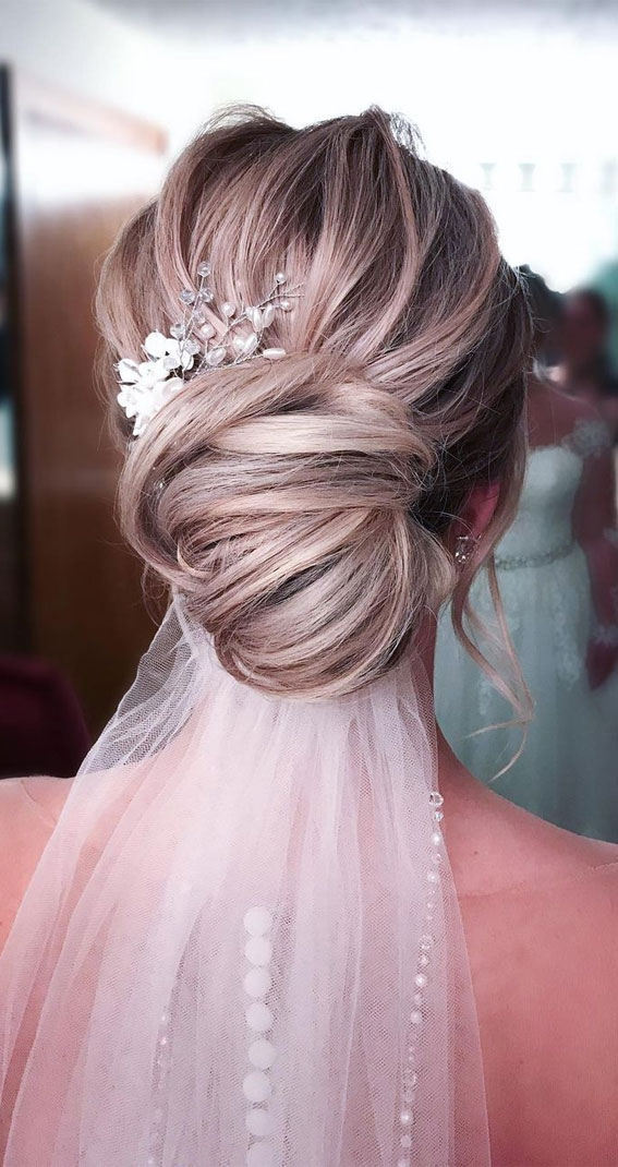 Updo Hairstyles For Your Stylish Looks In 2021 : Chignon with veil