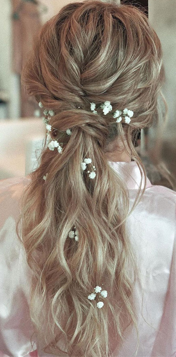 High And Low Ponytails For Any Occasion : ponytail with Baby's breath