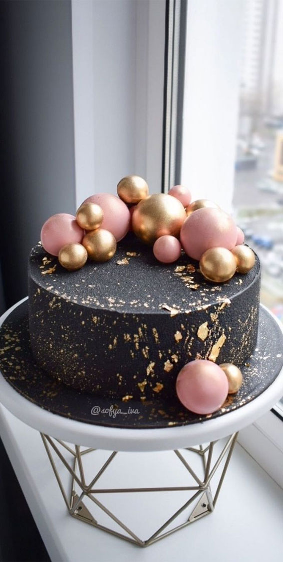 39 Cake design Ideas 2021 : Black Cake Topped with Pink & Gold Balls