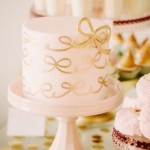 pink gold wedding cake with gold bow
