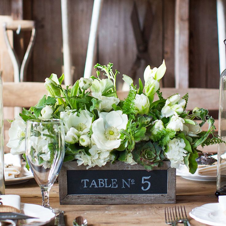Simple floral wedding centerpieces in wooden box with