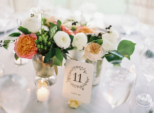 simple floral wedding centerpieces in mercury glass vases