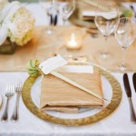 Gold and champagne reception table setting, wedding place setting