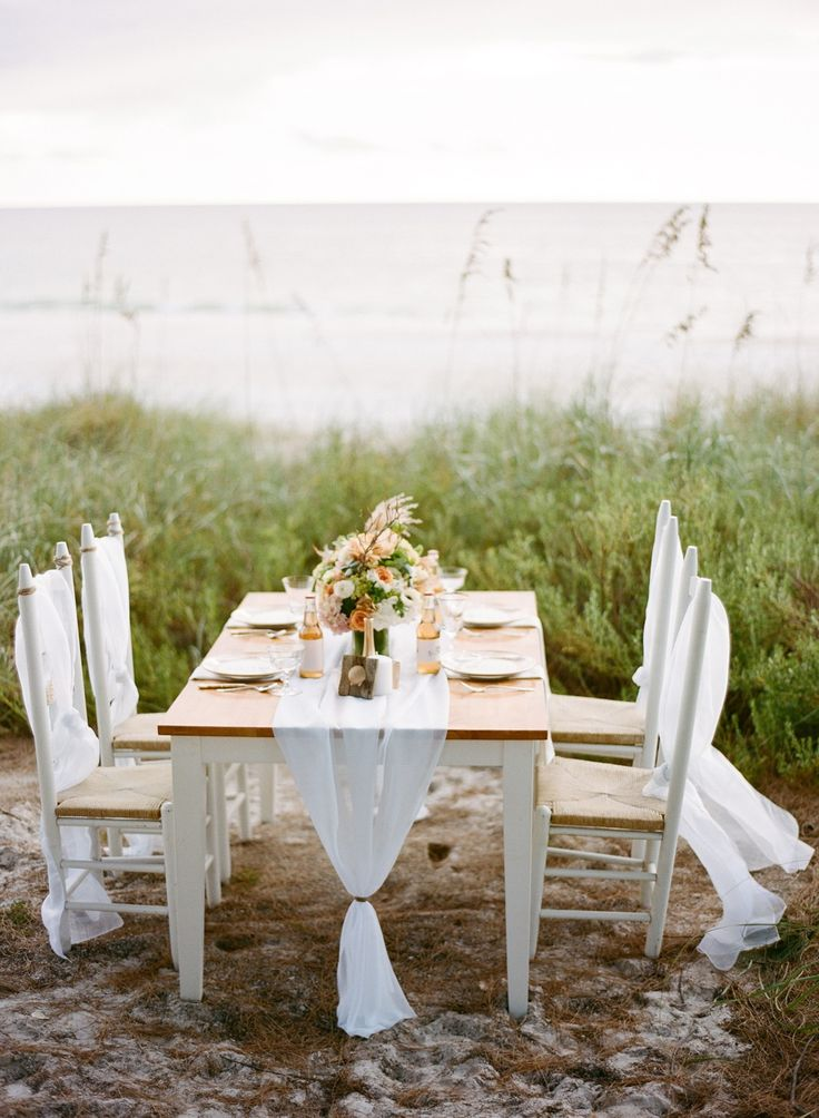 Simple wedding reception table setting on the beach fab for Simple wedding decorations for reception