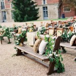 wedding ceremony benches with flowers
