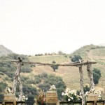 Rustic ceremony arch with wine barrels