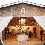 Barn Reception With Sheer Curtains and Chandelier