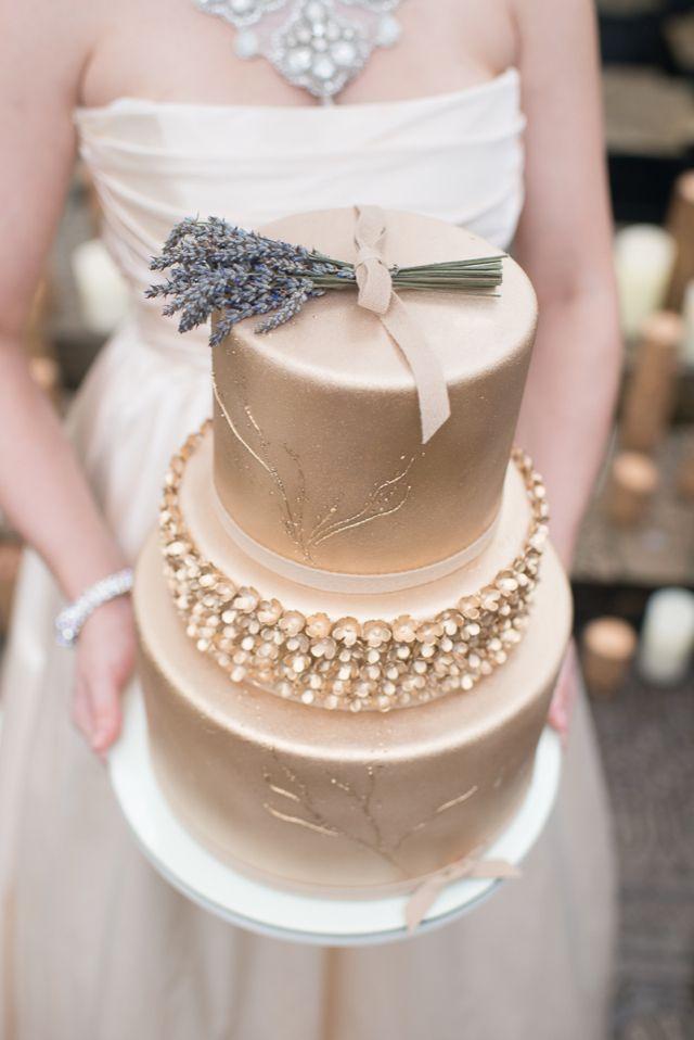 gold wedding cake topped laveder