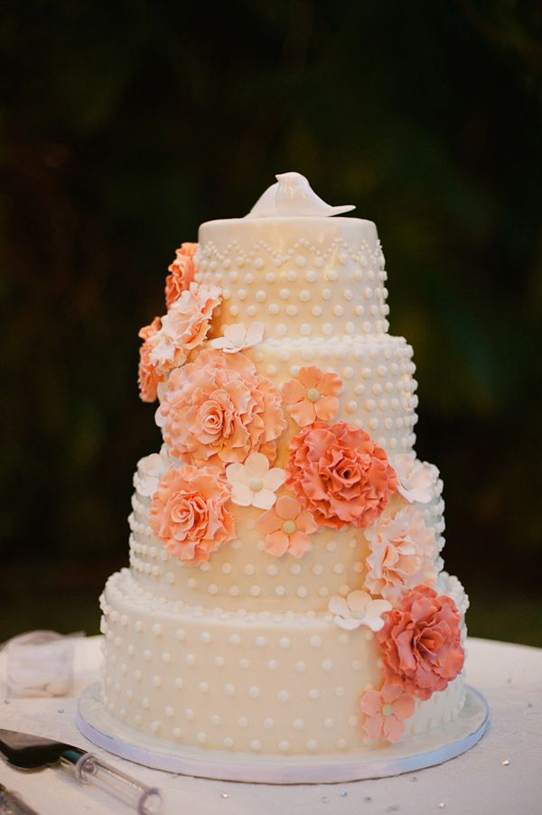 peach wedding cake with flowers