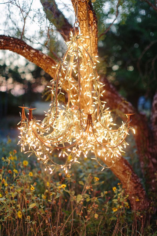 whimsical wedding lighting idea - string lights wrapped around a wire DIY chandelier
