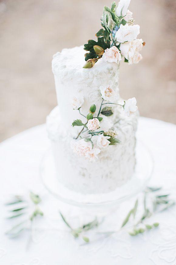 white wedding cake,white wedding cake with flowers,elegant wedding cake