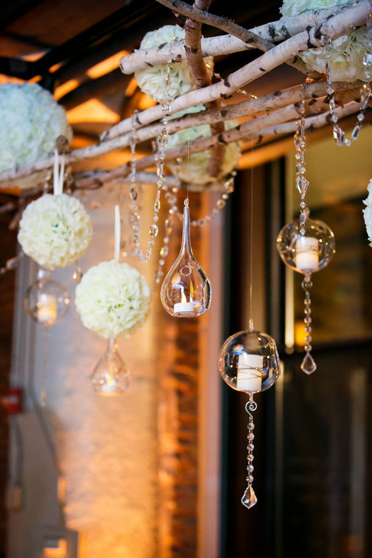 hanging floral poms and candle votives