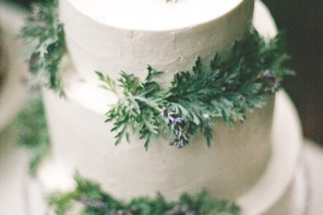 white wedding cake with green leaves