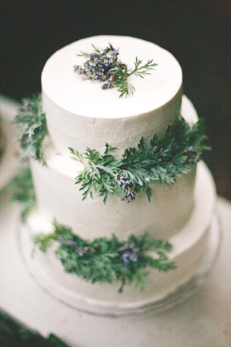 white wedding cake,white wedding cake with green leaves