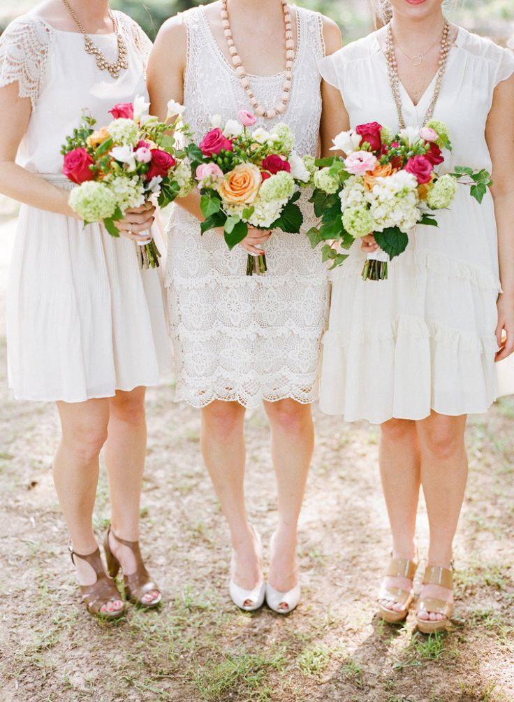 Mismatched pretty white bridesmaid dresses with 1920s edge, with lace, ruffles and worn with beads