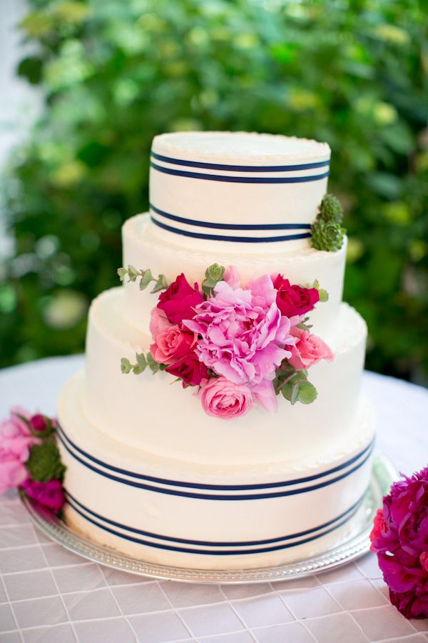 pink fresh flower on navy stripe wedding cake