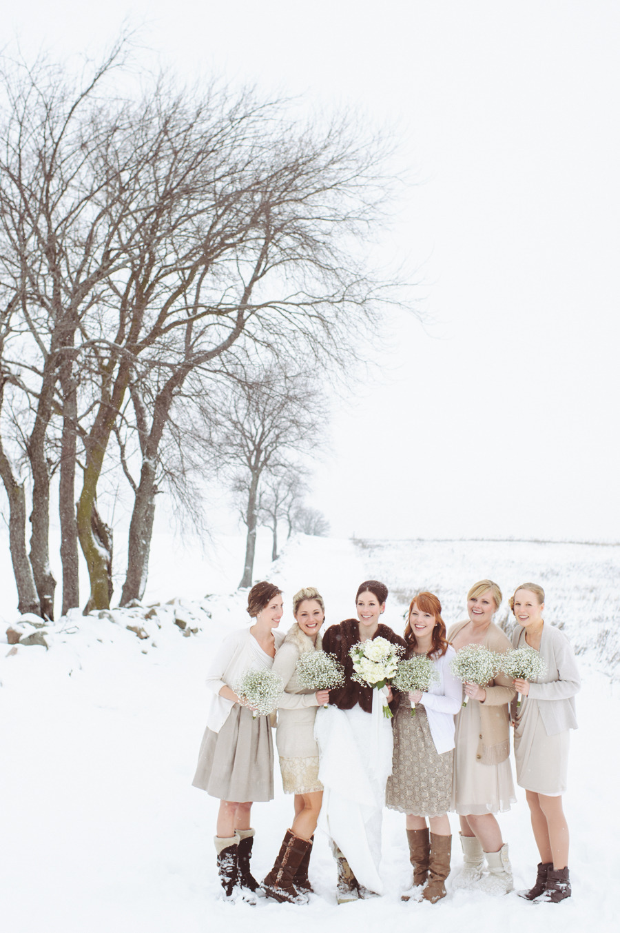 bride and bridesmaids in snow | Photography Paper Antler Photography