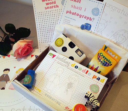 """wedding activity box for kids - disposable camera, """"picture search"""", wedding word search, handmade wedding coloring book/crayons, finger puppets, stuffed animal, treats... CUte packaging ideas too."""