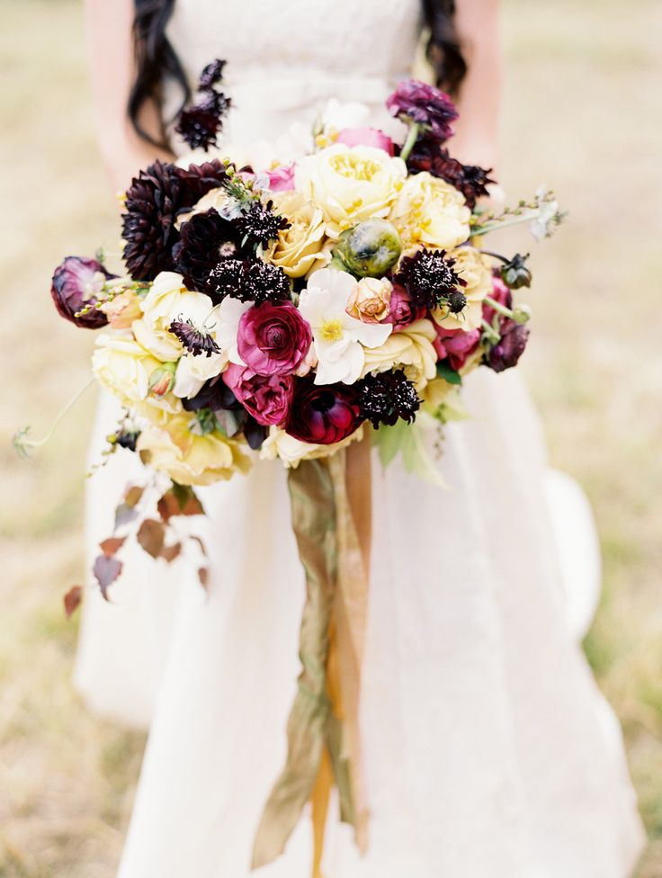 jewel tone bouquet with gold ribbons perfect for autumn wedding