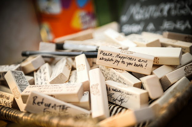 15 Unique wedding reception ideas on a budget – A guest book consisting of Jenga blocks signed by the wedding guests
