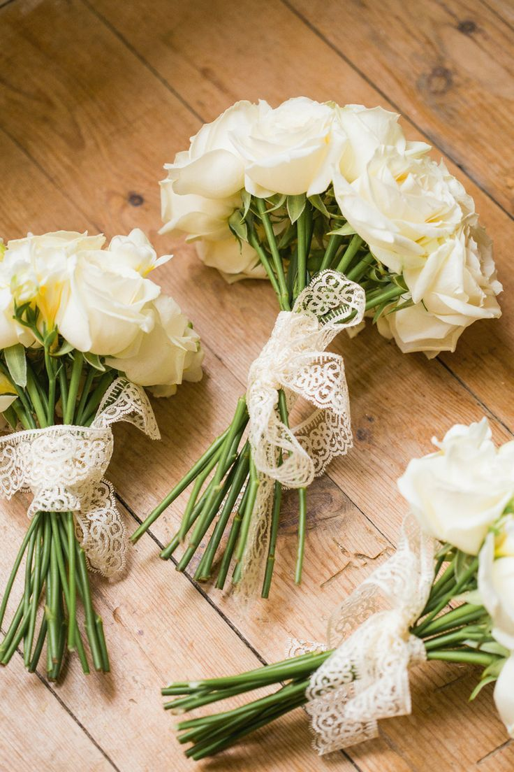 Unique wedding reception ideas on a budget – Simple White rose bouquet tied with lace