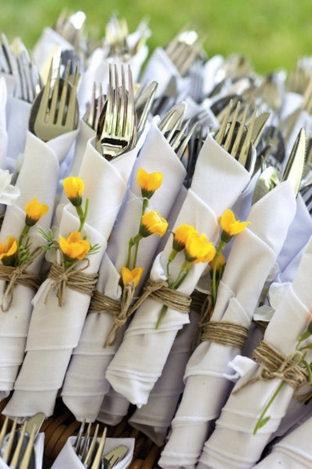 Unique wedding reception ideas on a budget – Silverware tied with twine and wildflowers