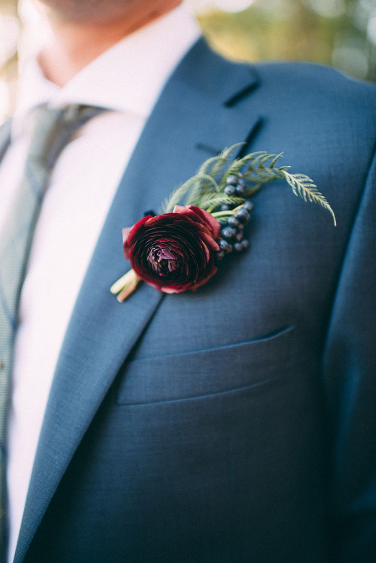 Burgundy Boutonnieres on navy blue suit perfect for fall wedding