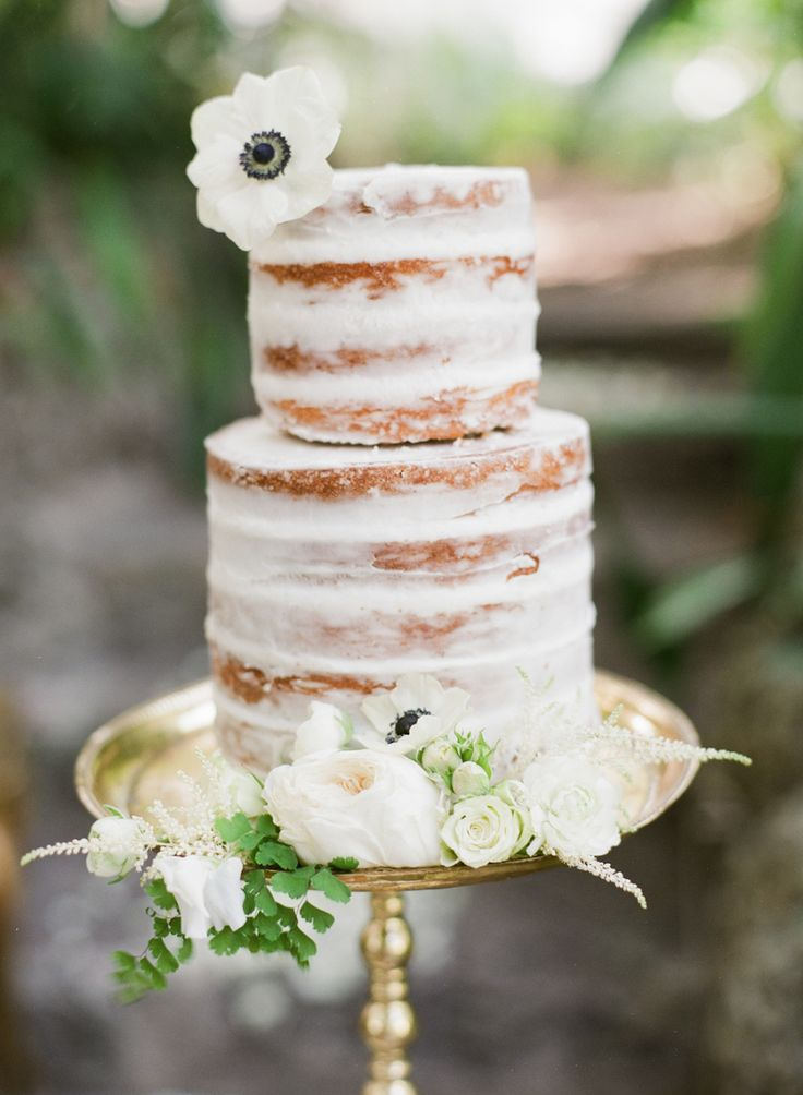 Photography : giannycampos.com | Nearly naked wedding cake with flowers accents | see more 24 Semi Naked Wedding Cakes With Pretty Details on fabmood.com