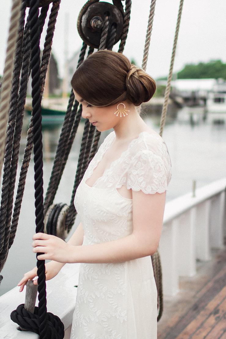 Cap sleeves wedding gown from Saja Wedding - Nautical Wedding Inspiration shoot | justinabilodeauphotography.com | #weddinginspiration on fabmood.com