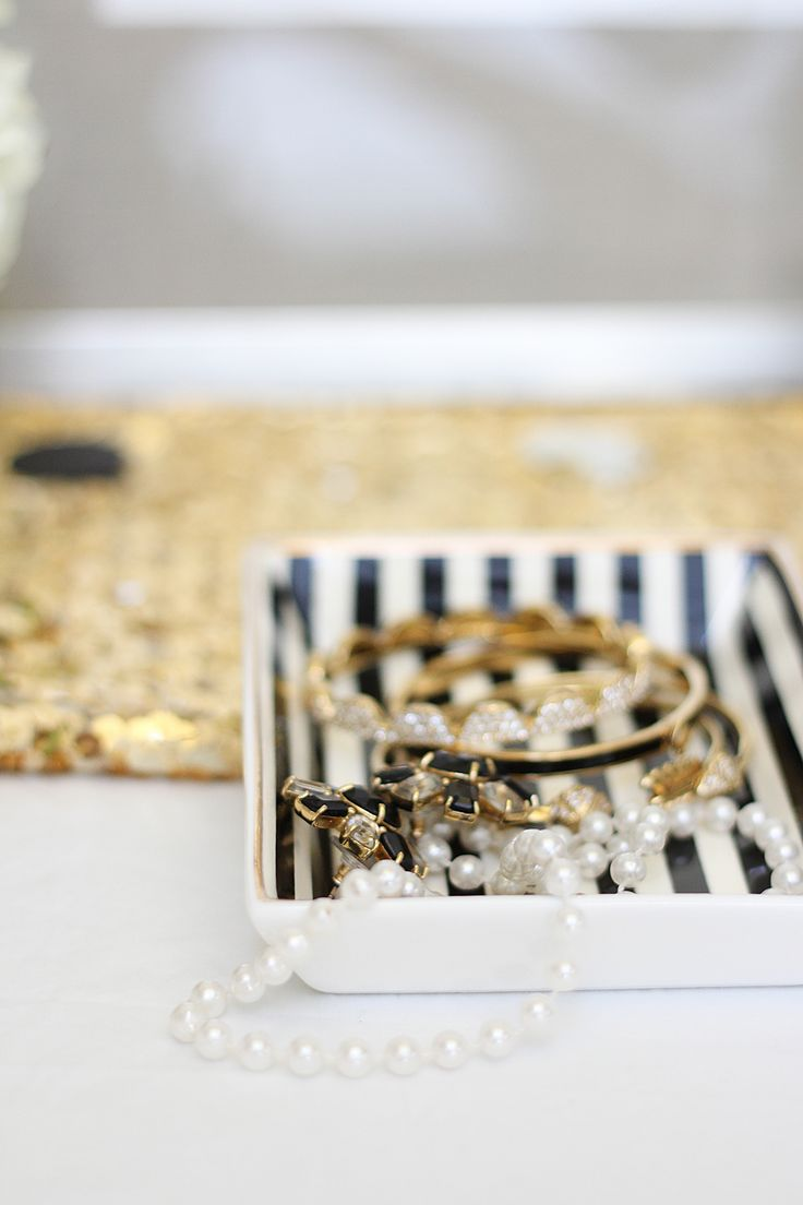 Stripe the inside of a plain white tray and tuck your jewels into it