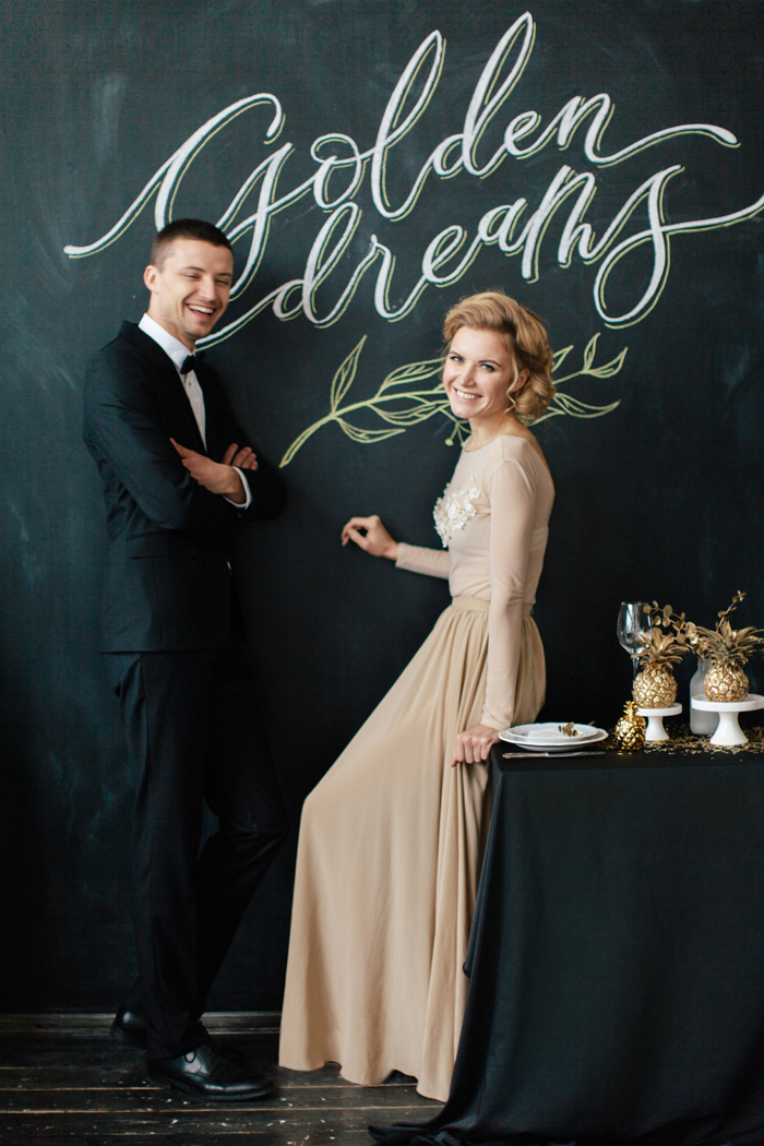 bride in light gold wedding dress - love chalk board wedding backdrop | fabmood.com