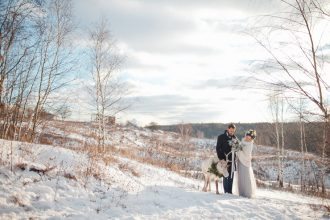 Light blue wedding dress + Muted grays and blues For an outdoor winter wedding shoot in the snow | fabmood.com #winterwedding #blueweddingdress #brideandgroom #snow