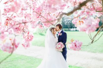 Soft pink and white Wedding for A Pretty, Relaxed and Fun Spring Time wedding At Hayne House | fabmood.com #springwedding #weddingportraits #brideandgroom #cherryblossoms #weddingphoto