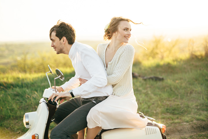 Adorable bride and groom having ride on vespa   engagement session   fabmood.com #wedding #weddingportrait