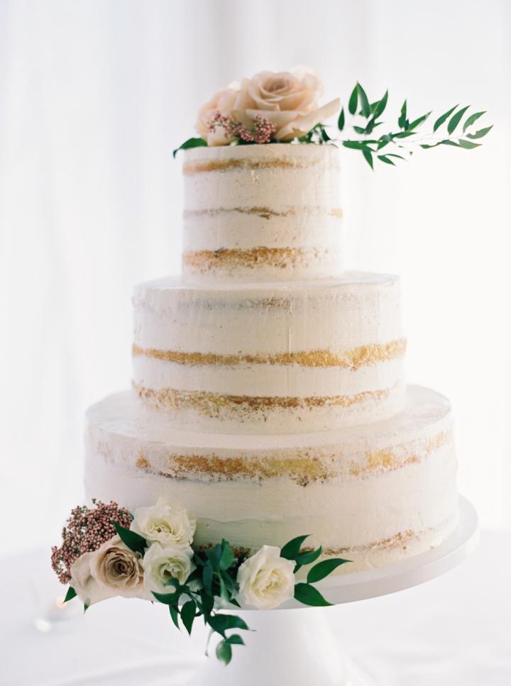 Semi naked wedding cake topped with roeses   fabmood.com #weddingcake #cakes #nakedcake #seminakedweddingcake