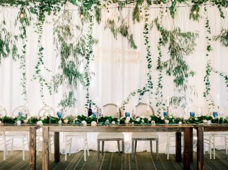 Disney-inspired wedding details - wedding quote on fabric wedding back drop + farm styled wedding table #weddingdetails #weddingdecor #weddingbackdrop #fabricdraped