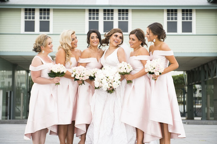 Blush pink bridesmaid dresses + blush and white wedding bouquets
