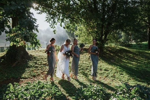 Rustic mountain wedding with lush greenery and red details