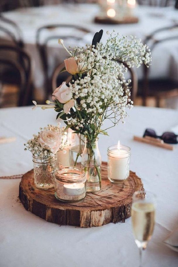 Old glasses + candles and wooden slice used for wedding centerpieces