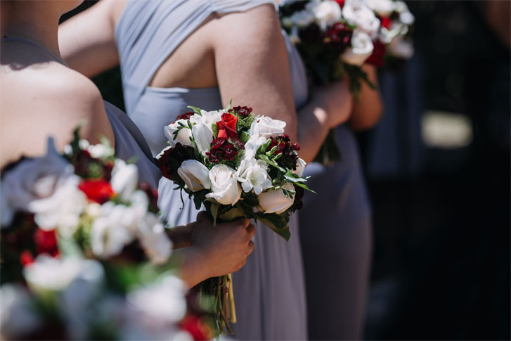 Blue grey bridesmaid dress + white and red bouquets for a gothic style wedding #weddingideas #bouquet