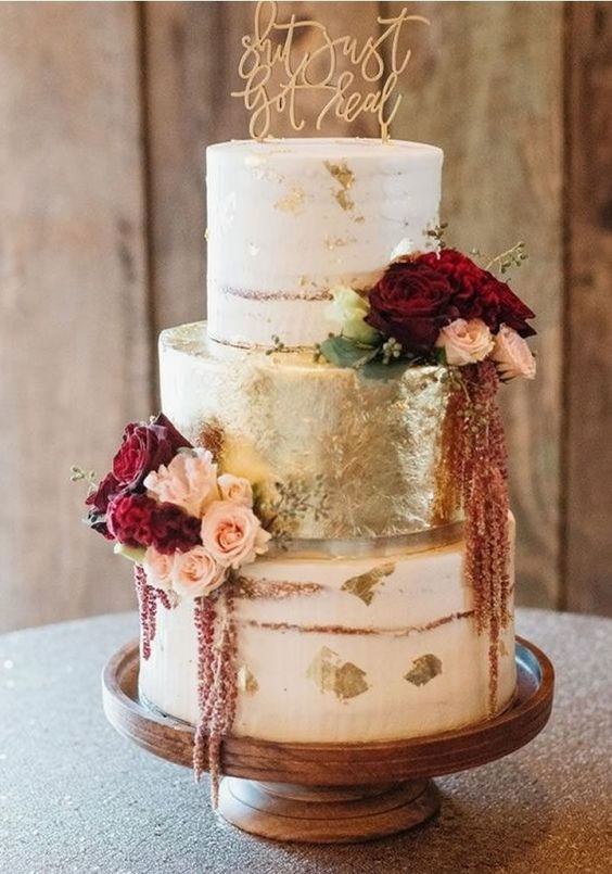 Three tier semi naked wedding cake with gold and burgundy details #fallwedding autumn wedding cake