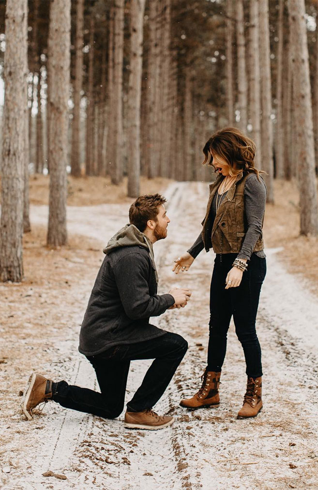 Surprise romantic proposal at a Christmas tree farm