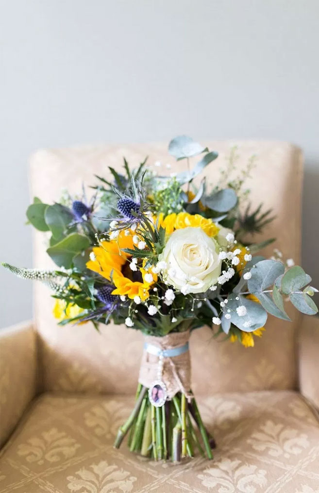 This sunflower bouquet is so cheerful and pretty! Mix of Rose + Thistle and Sunflowers #bouquet #sunflowers